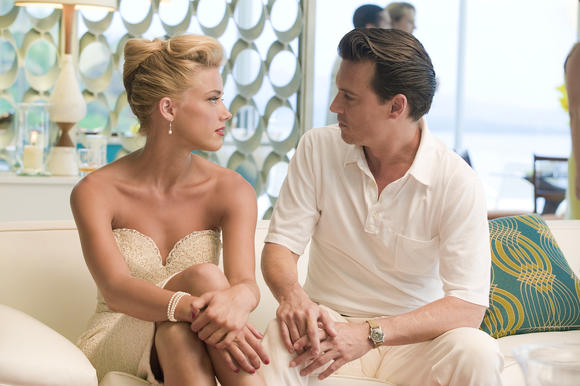 "Amber Heard and Johnny Depp in ""The Rum Diary"""