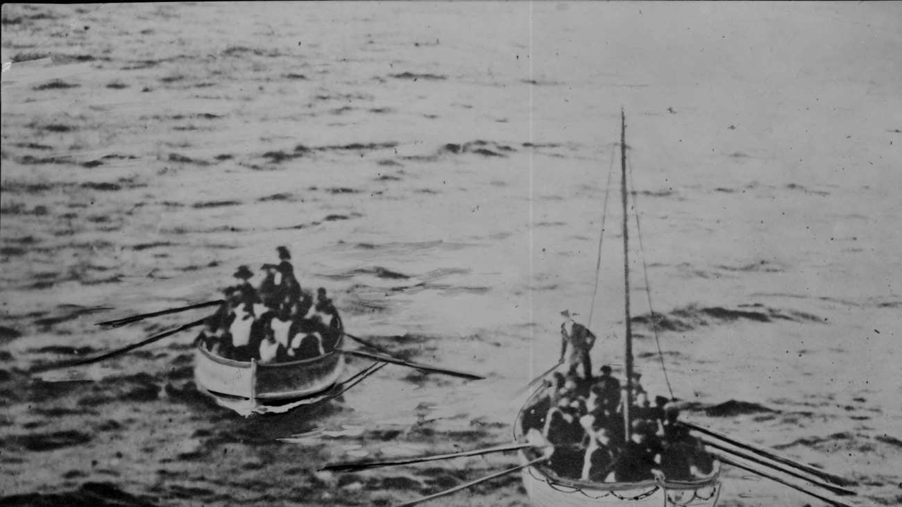 Lifeboats carry survivors of the real-life sinking of the the Titanic.
