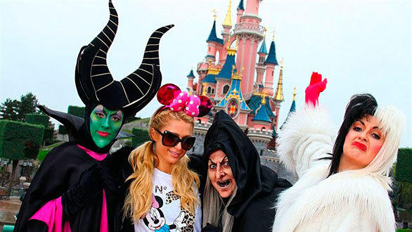 "Paris Hilton with Maleficent, the Evil Queen from ""Snow White"" and Cruella De Vil at Disneyland Paris."