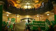 Unions members rally against proposed pension legislation in the rotunda of the Illinois State Capitol in Springfield Wednesday, October 26, 2011.    (E. Jason Wambsgans/ Chicago Tribune)