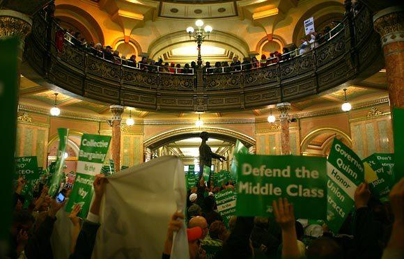 Unions members rally against proposed pension legislation in the rotunda of the Illinois State Capitol in Springfield Wednesday, October 26, 2011.