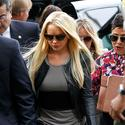 Lindsay Lohan surrenders to serve sentence