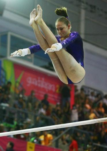 Bridgette Caquatto winning uneven bars gold Thursday.  Grace Chiu/GraceClick/USA Gymnastics)