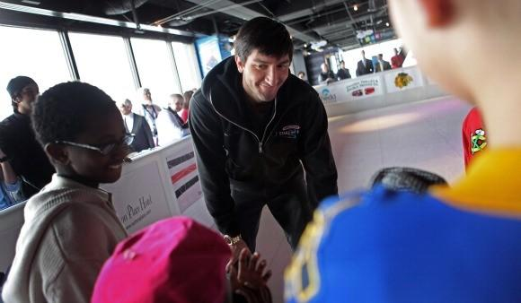 Evan Lysacek with young skaters at the John Hancock Observatory rink last February.  (Heather Charles / Chicago Tribune)