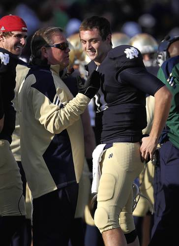 Coach Brian Kelly talks with Tommy Rees after Rees threw a touchdown pass to Michael Floyd.