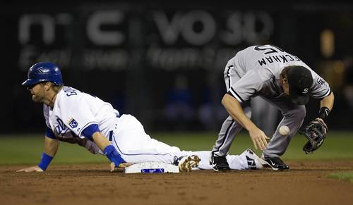 Royals' Alex Gordon slides into second for a steal as Gordon Beckham drops the ball in the first inning.