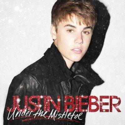 """It bears mentioning that Biebs teams with Busta Rhymes on """"Drummer Boy."""" You were waiting for that, right? Can't say I'm surprised Bieber went the Christmas album route, but picturing him kissing a girl """"under the mistletoe"""" is a bit much. <br><br> Who to buy it for: No one"""