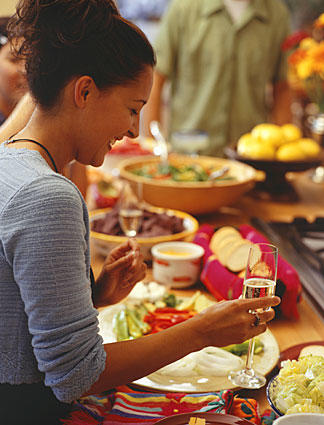 """<b>Not my mother's dinner party:</b> Today's host does not have time to """"be a Martha Stewart,"""" says Holland. """"But we can show our guests we care."""""""