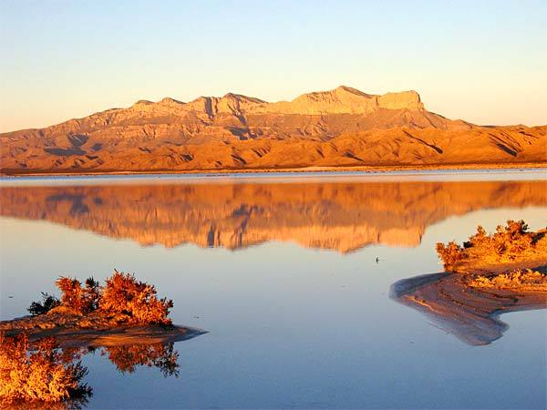 "<b>Guadalupe Mountains National Park </b><br> <i> <a class=""taxInlineTagLink"" id=""PLGEO100104600000000"" title=""Texas"" href=""/topic/us/texas-PLGEO100104600000000.topic"">Texas</a></i><br> <br> <b>Distance: </b>912 miles one-way<br> <br> Guadalupe Mountains park in far West Texas is a hiker's paradise, with more than 80 miles of mild trails through canyons and springs and more strenuous back-country hikes where steep mountain switchbacks lead into the wilderness. The park also has sandy dunes and dry salt lakes.<br> <br> -- Kelsey Ramos<br> <br> <b>More info: </b><br> <br> <a href=""http://www.nps.gov/gumo"">http://www.nps.gov/gumo</a>"