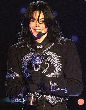 Michael Jackson holds the Millennium Award at a ceremony in May 2000 in Monaco.