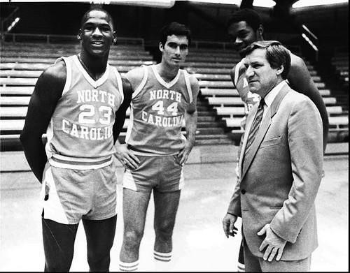 Michael Jordan in his college days with teammates Matt Doherty (44) and Sam Perkins and coach Dean Smith.