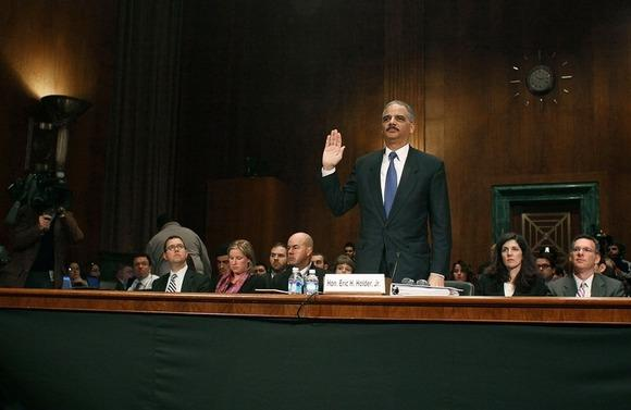 "Atty. Gen. Eric H. Holder Jr. is sworn in before testifying during a Senate Judiciary Committee hearing about the controversial ""Fast and Furious"" gun-running program."