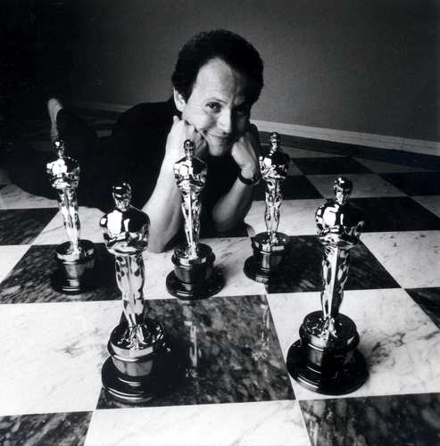 """On Nov. 10, 2011, the Academy of Motion Picture Arts and Sciences announced that actor-comedian Billy Crystal would replace Eddie Murphy as <a href=""""http://latimesblogs.latimes.com/movies/2011/11/billy-crystal-oscar-host-grazer.html"""" target=""""blank"""">the host of the 84th Academy Awards</a>, which would mark his ninth time hosting the Oscars.<br> <br> """"Some of the best moments of my career have happened on the Oscar stage. I am thrilled to be back there,"""" the comedian said in a statement. """"Actually, I am doing this so that the young woman in my pharmacy will stop asking me my name when I pick up my prescriptions.""""<br> <br> In the photo above, Crystal poses with Oscar statuettes in 1990. Click on for a look at some of his memorable moments as host."""