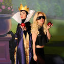 "Lady Gaga shares an apple with the Evil Queen from ""Snow White and the Seven Dwarfs"" at the Magic Kingdom."