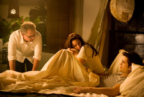"Director Bill Condon, Kristen Stewart and Robert Pattinson talk on the set of ""The Twilight Saga: Breaking Dawn - Part 1."""