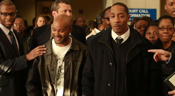 Vincent Thames (center) and Terrill Swift (right) stand at a press conference announcing their new trials, as well as for Michael Saunders and Harold Richardson, in the 1994 murder of Nina Glover in Englewood. DNA evidence has implicated another person in the crimes, casting doubt on the original four convictions for the crime.
