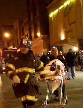 Emergency personnel rush victims from the Epitome nightclub.