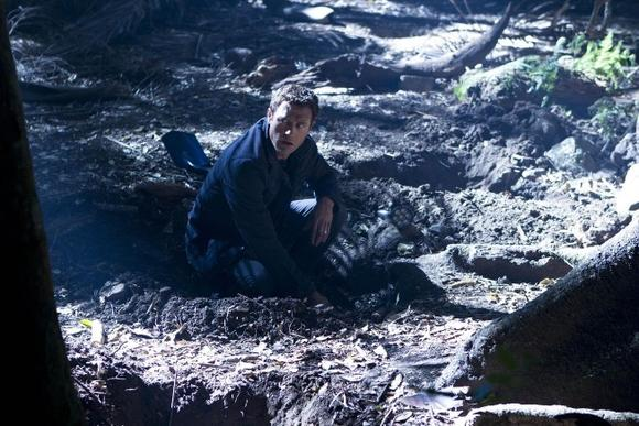 Jim finds a buried skeleton outside Terra Nova in 'Vs.'