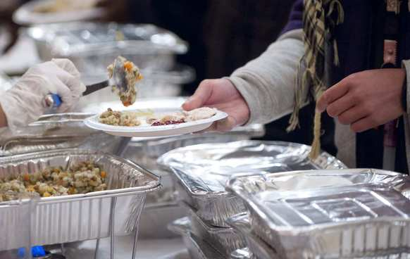 Occupy D.C. demonstrators receive a Thanksgiving meal from volunteers at the New York Avenue Presbyterian Church in Washington.