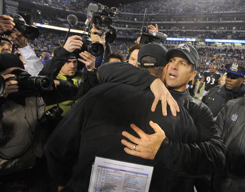 Ravens coach John Harbaugh hugs 49ers coach Jim Harbaugh, his younger brother, after Baltimore's win over San Francisco.