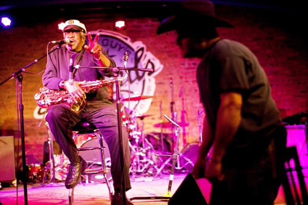 Miguel Nunez of Chicago dances as Chicago bluesman Eddie Shaw performs with his band The Wolf Gang at Buddy Guy's Legends blues club in Chicago.