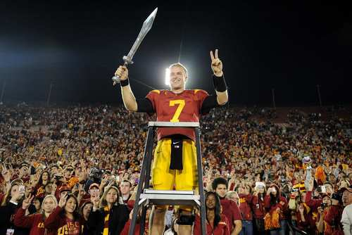 Trojans quarterback Matt Barkley leads the band after defeating UCLA, 50-0, on Saturday night at the Coliseum.