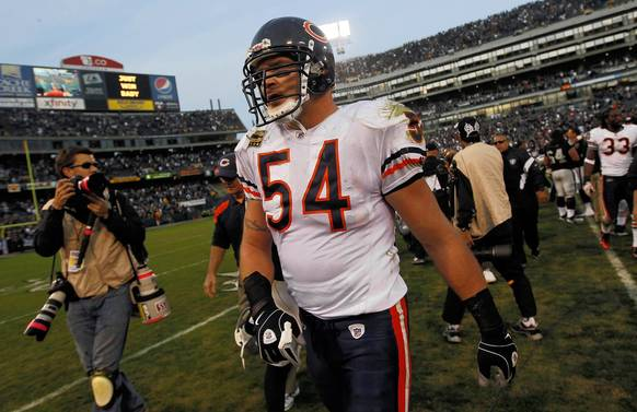 Brian Urlacher walks off the field after the game.
