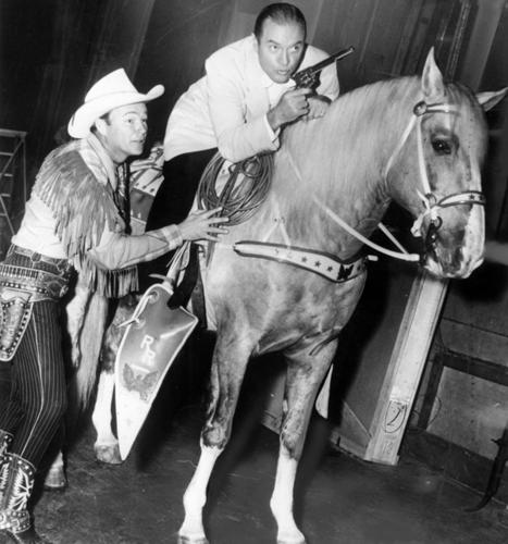 "<b>White hat:</b> With more than 100 cowboy movies to his name, Roy Rogers played himself as the owner of the Double R Ranch in this TV series, alongside wife Dale Evans, sidekick Pat Brady, horse Trigger and German shepherd Bullet. Every week, Roy Rogers and his posse rescued the weak and helpless. Each episode ended with the show's theme song, ""Happy Trails"" written by the Queen of Cowgirls herself, and crooned by Dale and Roy over the credits.<br> <br> <b>Black hat:</b> Each week brought its own set of black hats, including claim jumpers, rustlers, tyrannical lawmen and corrupt financiers.<br> <br> <em>Pictured above: Bob Hope demonstrates his riding technique for Trigger and Roy Rogers in 1951, before the debut of ""The Roy Rogers Show.""</em>"