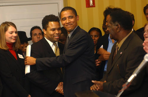 At a news conference at the Allegro Hotel, then-Illinois Sen. Barack Obama receives well-wishes from U.S. Rep. Jesse Jackson Jr. and state Senate President Emil Jones Jr. (right). Obama announced his intentions to run in the 2004 U.S. Senate Democratic primary.