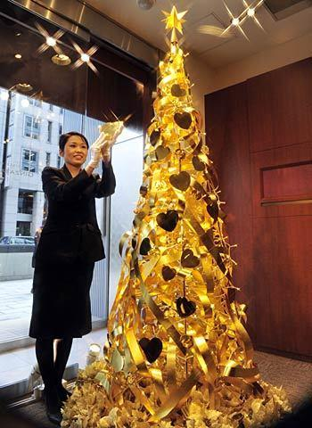 What this tree lacks in height, it makes up in cost. The tree, which is on display in the Tokyo store of Japanese jewelry retailer Tanaka Kikinzoku, is crafted out of gold. It stands a little under 8 feet but is valued at about $2 million.