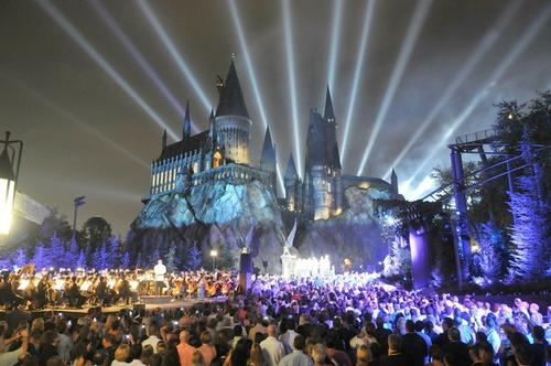 """The Wizarding World of Harry Potter kicked off its grand opening celebration with help from """"Harry Potter"""" film stars Tom Felton, Michael Gambon, Bonnie Wright, Oliver Phelps, Daniel Radcliffe, Matthew Lewis, Warwick Davis, Rupert Grint and James Phelps on June 16, 2010 in Orlando. Hundreds of people gathered in front of Hogwarts castle for a spectacular display of fireworks choreographed to a special performance of music from the """"Harry Potter"""" films conducted live by renowned composer John Williams."""