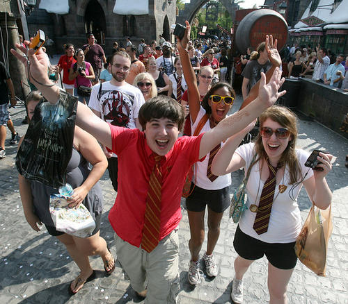 Harry Potter fans cheer during the official grand opening at the Wizarding World of Harry Potter at Universal Orlando, Friday, June 18, 2010.