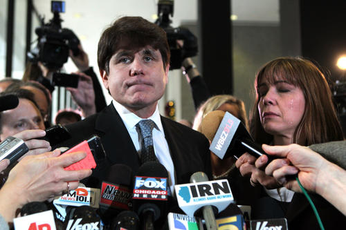 "<p>Former Gov. Rod Blagojevich and his wife, Patti, address the hoard of media at the Dirksen U.S. Courthouse on Dec. 6, 2011, after the former governor was sentenced to 14 years in prison. Blagojevich began his remarks by quoting a line from a Rudyard Kipling poem: ""If you can meet with triumph and disaster.""</p>"