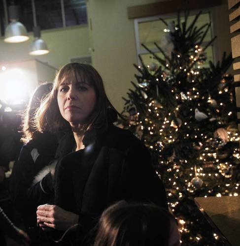 "Patti Blagojevich turns for the door after her family adopted a new dog named ""Luella"" from PAWS Chicago."