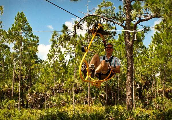 Theme Park Ranger Dewayne Bevil tries out Florida EcoSafaris' new Cypress Canopy Cycle, a cross of a bicycle and zipline through the wilderness of Osceola County in Holopaw, Fla. on Thursday, July 28, 2011.