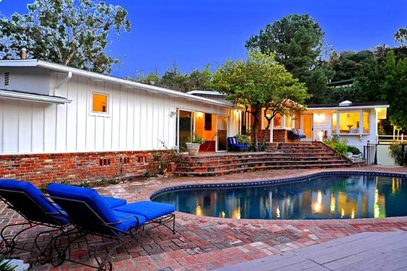 """""""King of the Hill"""" composer Roger Neill has put his Studio City house up for sale at $1.499 million."""