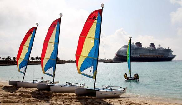 A family sails a catamaran at Castaway Cay, on the official christening cruise of the Disney Dream, from Por