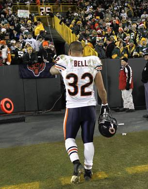 Khalil Bell leaves the field after a 35-21 loss to Green Bay.