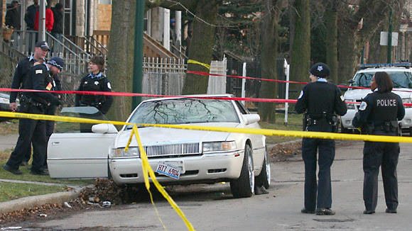 Chicago Police Dept investigate shooting at 60th Green Ave in Chicago.