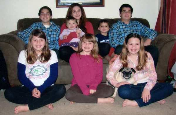 The Savona family poses for a Christmas photo in 2010. Gary Savona was left widowed with nine children after his wife, Sue, died due to complications from an emergency surgery on Dec. 18. (Photo courtesy of Gary Savona)