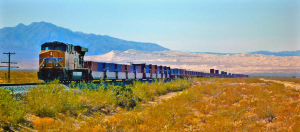 A Union Pacific  freight train is an hourly sight -- and sound -- in the Mojave National Preserve. The Kelso Dunes are in the background.