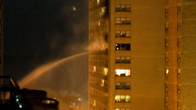 Firefighters work to extinguish a fire in a 21-story apartment building about 3 a.m. on Jan. 8, 2012. (Chicago Tribune)