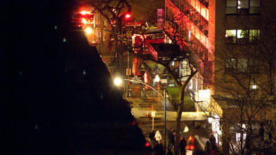 Firefighters and others outside an apartment building fire early Jan. 8, 2012. (Chicago Tribune)