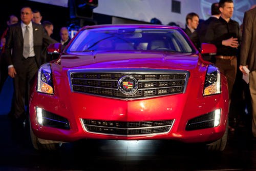 "At the Detroit show, Cadillac had fighting words backing up the ATS. GM North America president Mark Reuss said the car will challenge German supremacy in the sport-sedan segment. Touting the brand's latest small sedan. Reuss said the ATS is ""the most mass-efficient car in its segment,"" with a curb weight of well under 3,400 pounds. The proof will be in the driving, but the ATS fits the Cadillac lineup and it doesn't look deliberately scaled down."