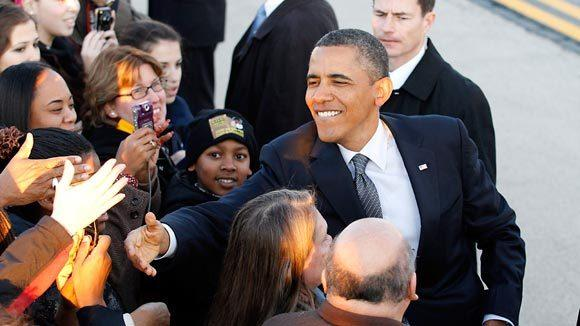 President Barack Obama greets supporters as he arrives at O'Hare International Airport Wednesday. (Nuccio DiNuzzo/ Chicago Tribune)