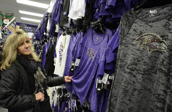 LuAnne Miller of Owings Mills is a regular customer at Baltimore Sports and Novelty store in the St. Thomas Shopping Center. Sales are brisk this week for Ravens merchandise.
