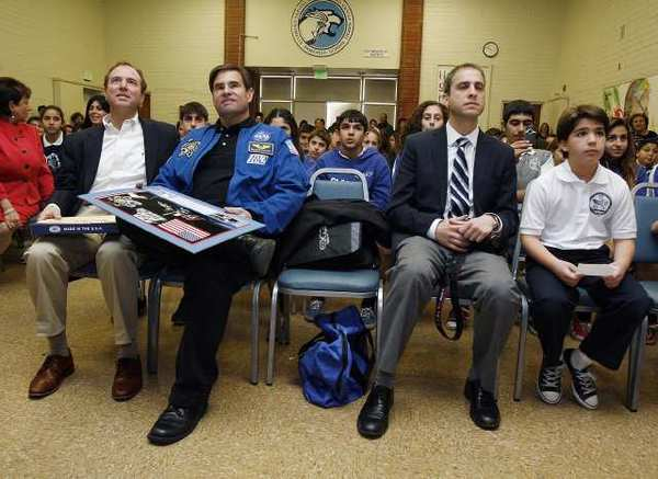 Sitting in the front row, Rep. Adam Schiff (D-Burbank), NASA astronaut Gregory Chamitoff, Saro Armenian, of Altadena, and his son Shant Armenian, 9, a student at Vahan & Anoush Chamlian Armenian School in Glendale on Friday, January 13, 2012. (Tim Berger/Staff Photographer)