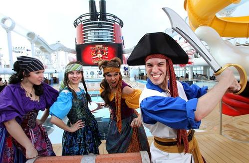 Pirates takeover the pool deck, to promote Thursday night's Mickey's Pirates in the Caribbean party, during the official christening cruise of the Disney Dream, from Port Canaveral, Fla., to Castaway Cay, Bahamas, Thursday, Jan. 20, 2011.