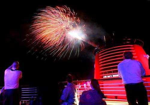 Guests watch fireworks launch during the Buccaneer Blast party, on the official christening cruise of the Disney Dream, from Port Canaveral, Fla., to Castaway Cay, Bahamas, Thursday, Jan. 20, 2011.