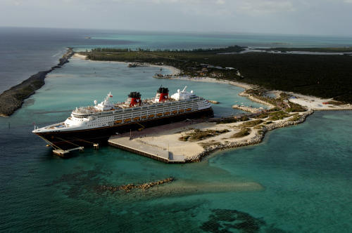 The Disney Magic sits at the dock at Castaway Cay. Amenities on the island are being adjusted in preparation for more ships (and bigger) being added to the Disney Cruise Line fleet. The Disney Dream debuts in 2011, followed by the Disney Fantasy.
